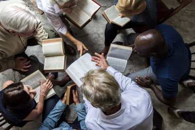 group christians reading bible together